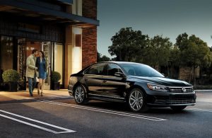 black 2019 volkswagen passat parked outside building in the evening