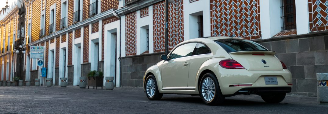2019 Volkswagen Beetle parked in front of a brick building