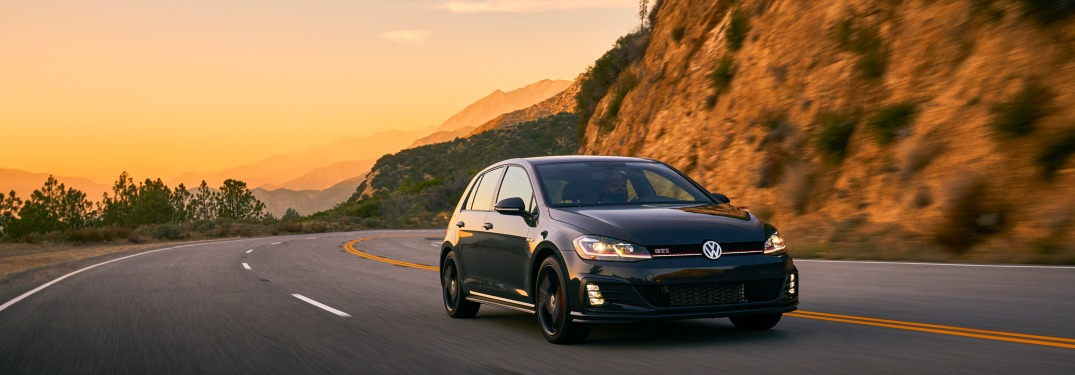 2019 Volkswagen Golf GTI driving down a mountainous road