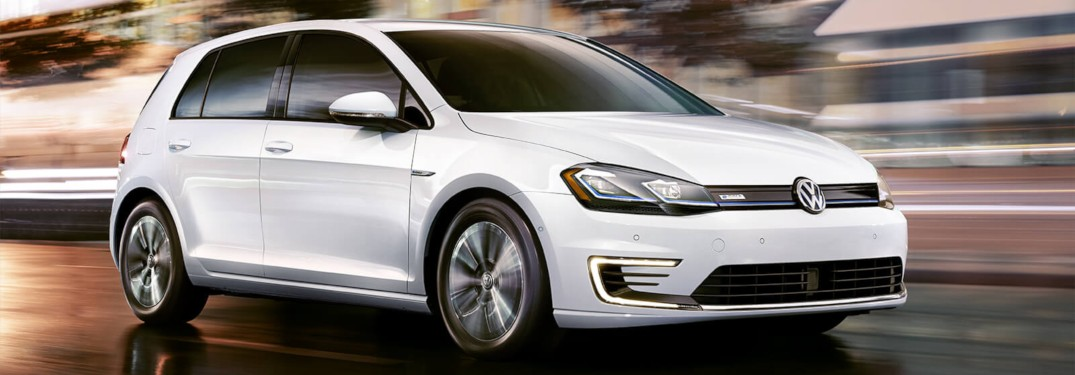 2019 Volkswagen e-Golf driving fast down a city street at night