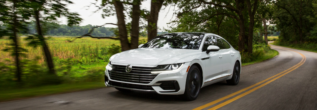 White 2019 Volkswagen Arteon driving on a country road