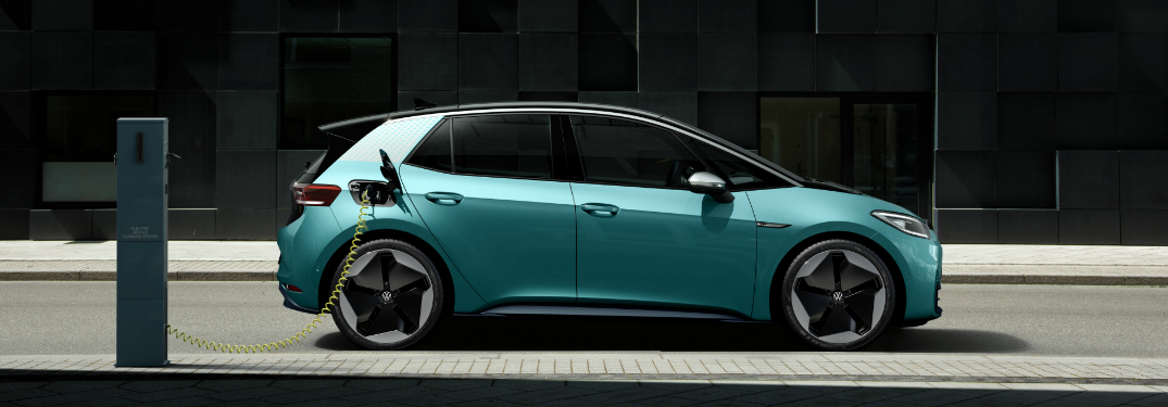 Teal Volkswagen ID.3 plugged into a charging station