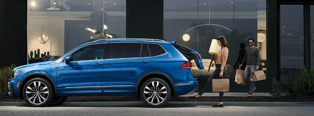 2020 VW Tiguan blue parked by building showing auto liftgate
