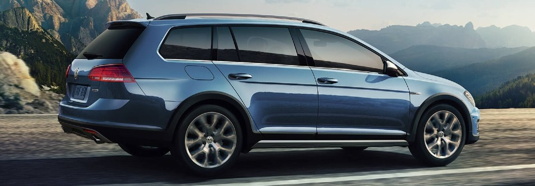 2020 VW Alltrack blue driving to the right through mountain road