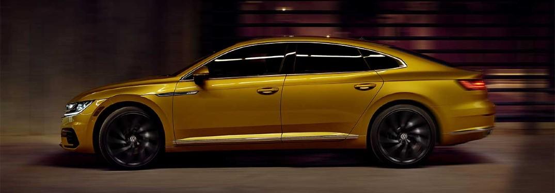 2019 Volkswagen Arteon dark yellow color driving at dusk
