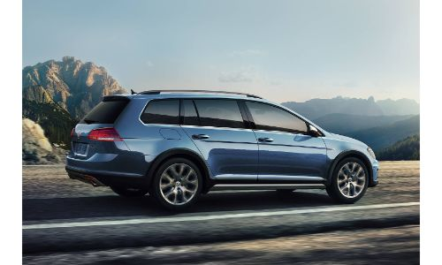 2019 Volkswagen Golf Alltrack SEL in silk blue metallic driving on mountain road with mists