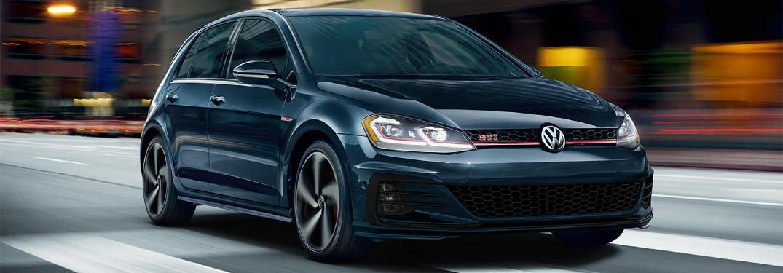 2019 Volkswagen Golf GTI driving fast through city