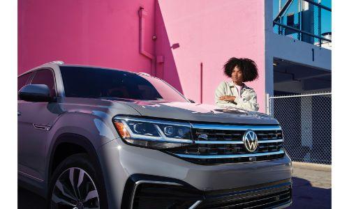 2020 Volkswagen Atlas Cross Sport exterior grey in front of pink wall