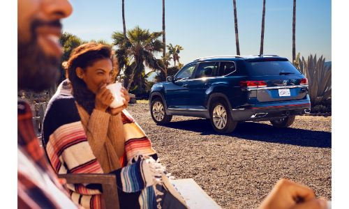 2020 Volkswagen Atlas distant shot facing away with people in foreground