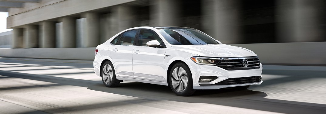 2020 Volkswagen Jetta White driving under bridge with shadows