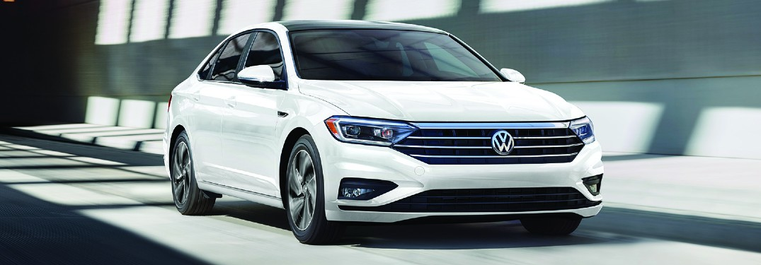 2020 Volkswagen Jetta white paint driving on road surrounded by concrete