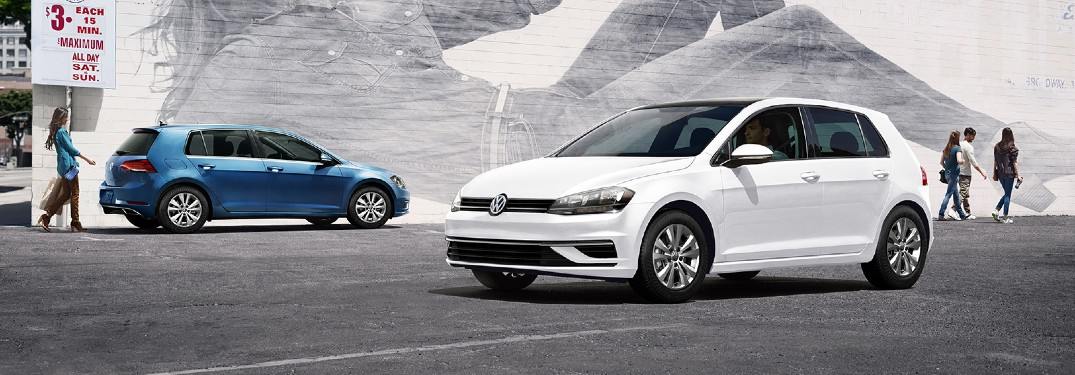 2020 Volkswagen Golf white and blue models in front of mural wall
