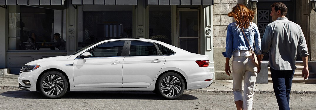 2020 Volkswagen Jetta white exterior shot with couple walking toward it