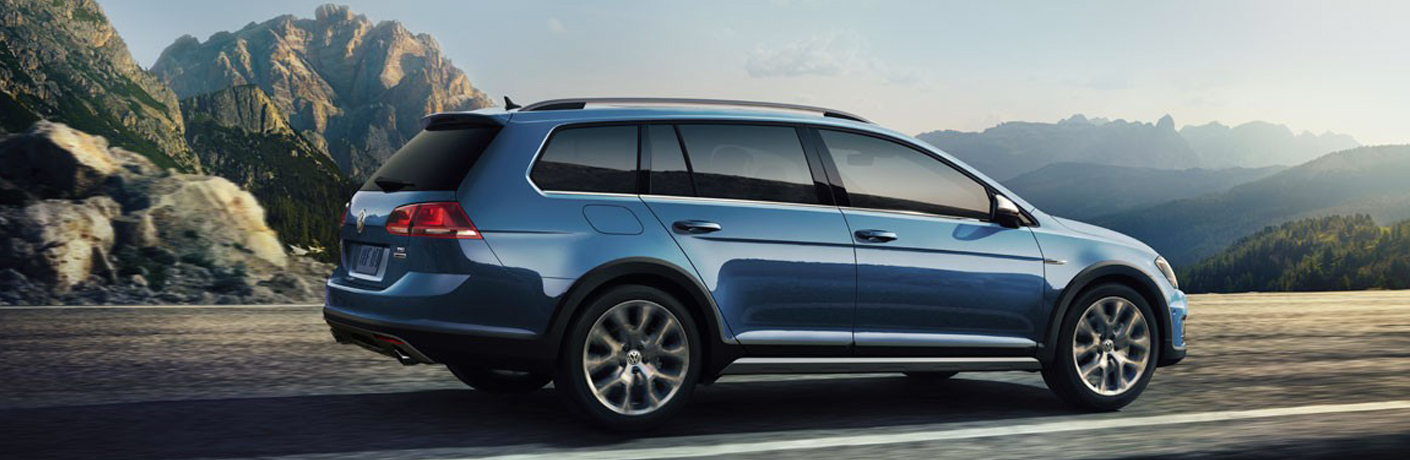 2018 golf alltrack blue on road