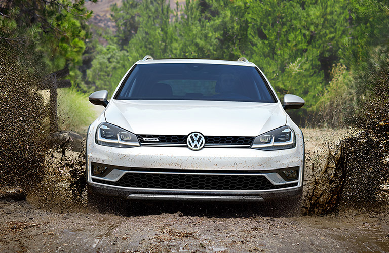 white vw golf alltrack in mud