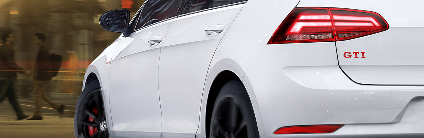 The rear and side view of a white 2019 Volkswagen Golf GTI