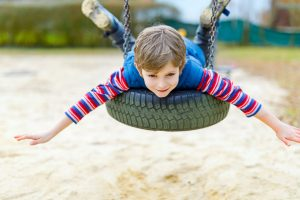 child on tire swing_b