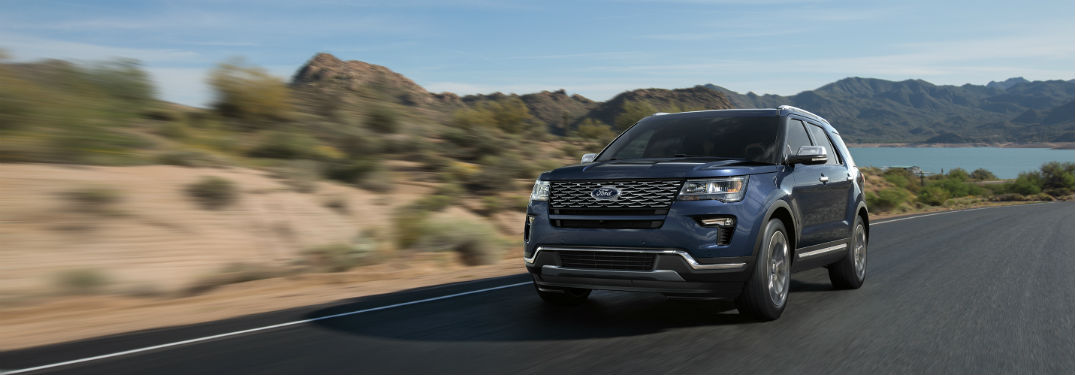 blue 2018 Ford Explorer driving along a desert road