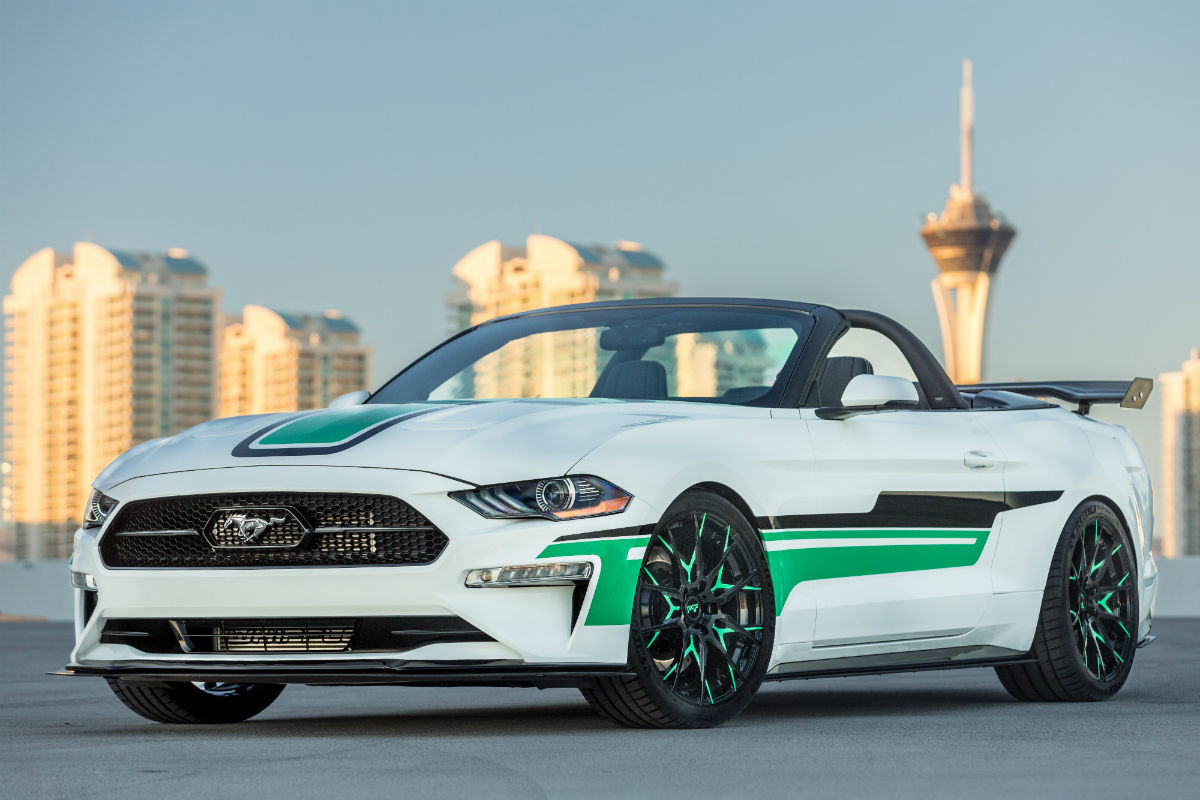 Custom 2018 ford mustang convertible with white and green exterior paint and a drag wing