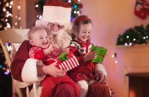 happy and smiling kids sitting on Santas lap