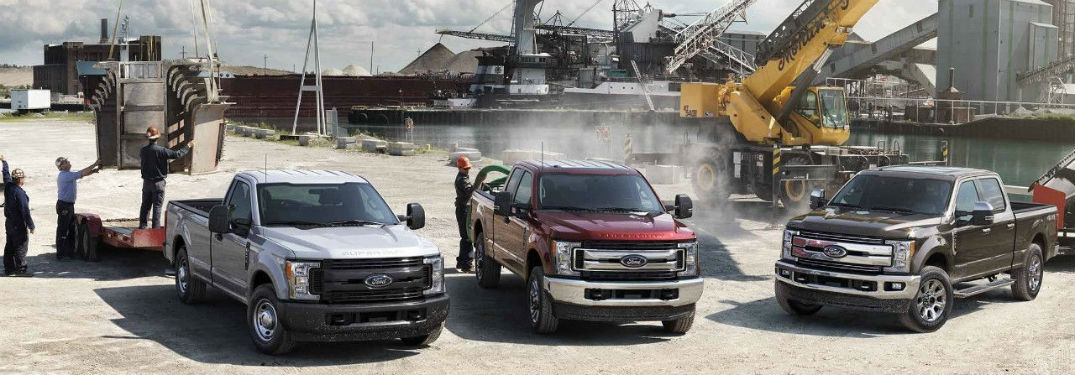 three 2018 Ford Super Duty models parked at a construction site