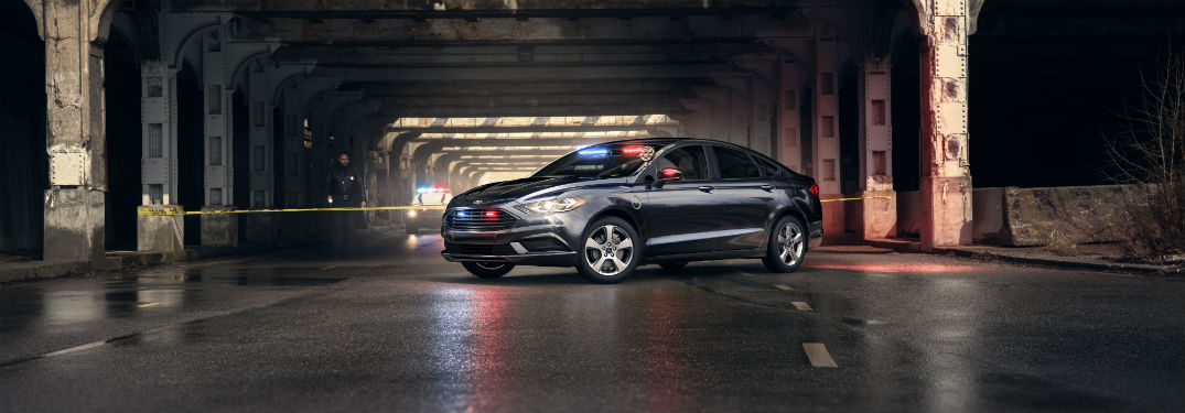 Ford Special Service Plug-In Hybrid Police Sedan parked at a crime scene in a tunnel