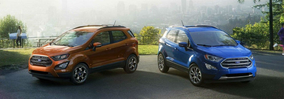 an orange 2018 Ford EcoSport and a blue 2018 Ford EcoSport sitting in a park