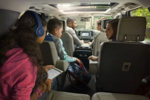 kids enjoying the entertainment features of a 2018 Ford Expedition