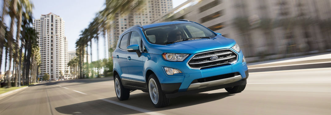 blue 2018 Ford EcoSport driving down a city street