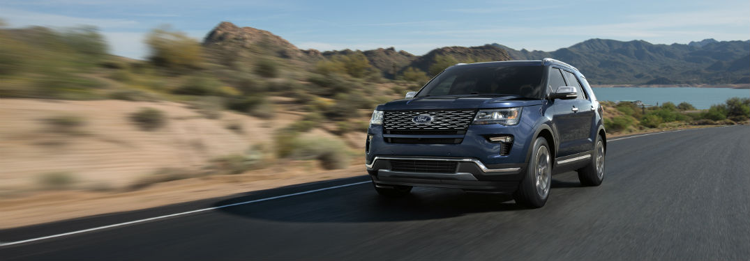 blue 2018 Ford Explorer driving down a desert road