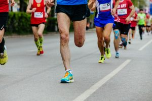 photo showing the legs of runners in a 5K