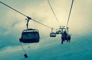 skiers riding a gondola