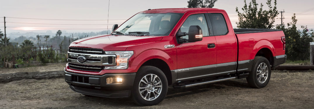 side view of a red 2018 Ford F-150 Diesel model