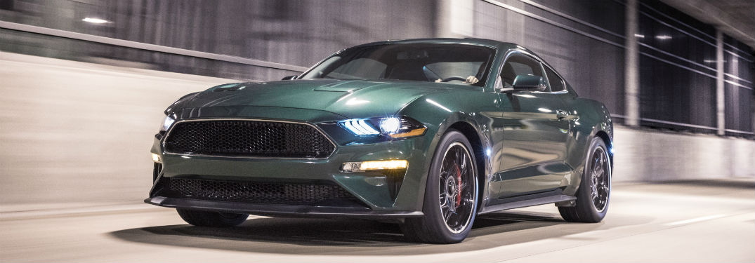 green 2019 Ford Mustang Bullitt pictured against a speed blurred background