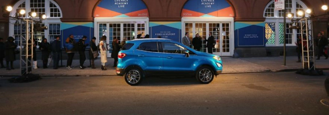 side view of a blue 2018 Ford EcoSport parked outside a warehouse