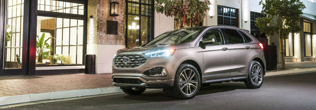 silver 2019 Ford Edge Titanium Elite parked on a city street