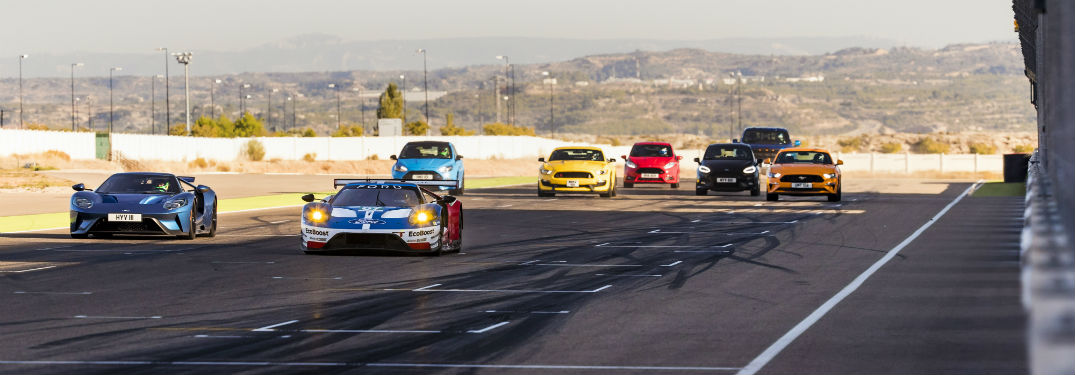 eight Ford Performance models racing on a track