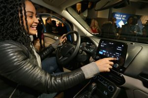woman using the infotainment system in her 2018 Ford EcoSport