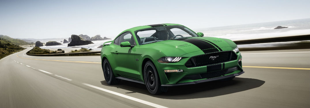 front view of a Need for Green colored 2019 Ford Mustang with a black stripe