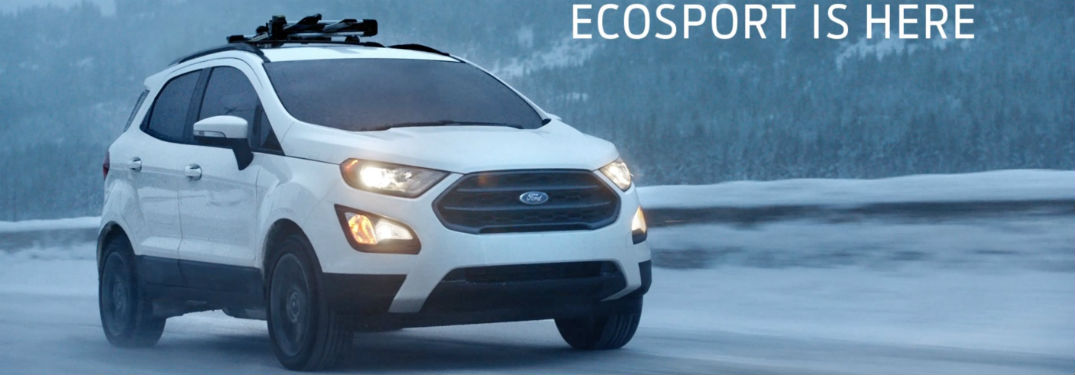 white 2018 Ford EcoSport driving through the snow with the words EcoSport is here toward the top