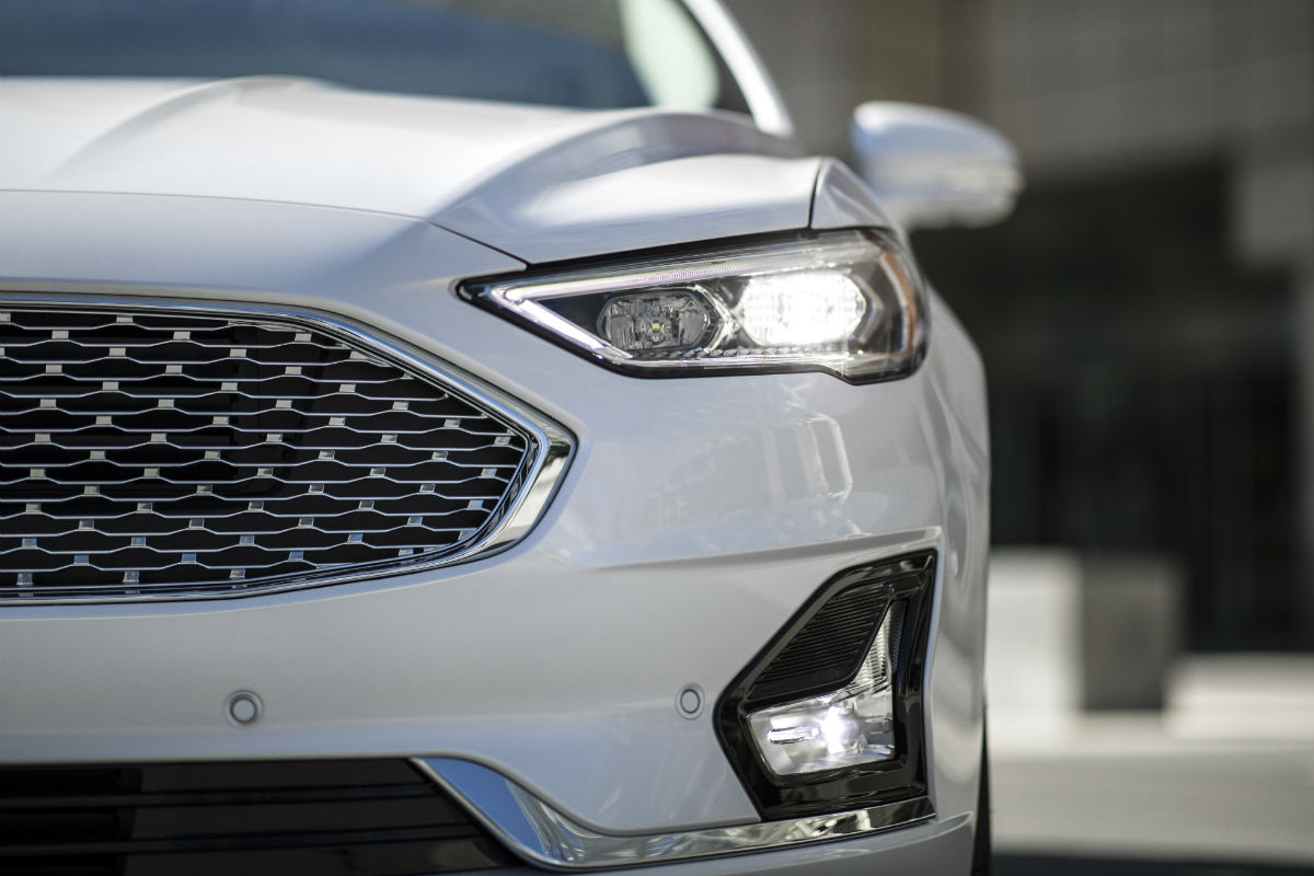 Close up of the front of a white 2019 ford fusion