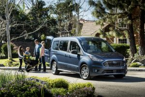 family loading up the back of their blue 2019 Ford Transit Connect Wagon
