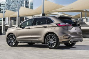side view of a tan 2019 Ford Edge Titanium Elite