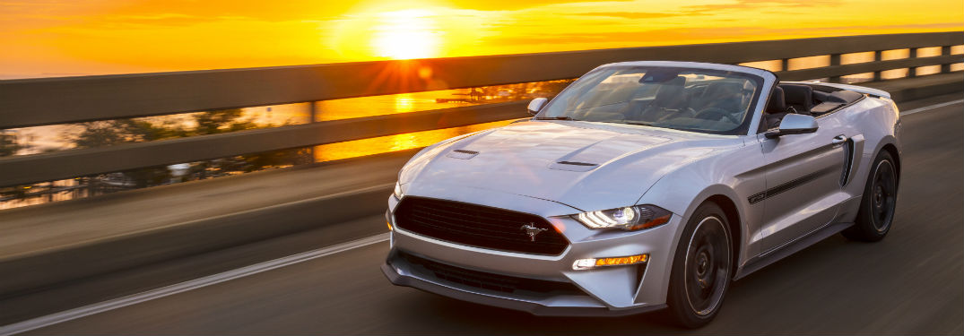 front view of a silver 2019 Ford Mustang California Special with a sunset in the background