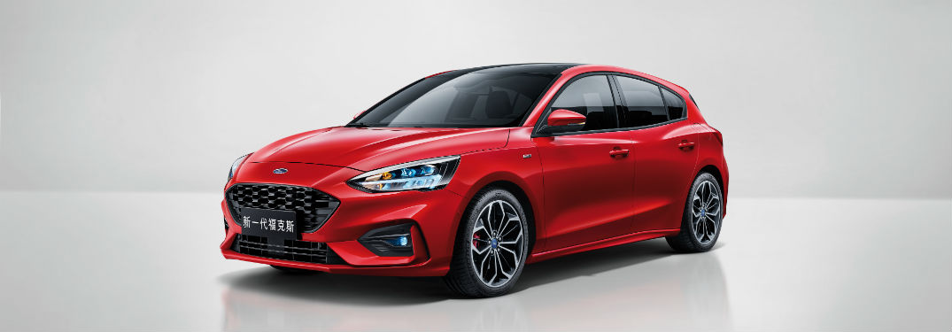 side view of a red Asian 2019 Ford Focus Hatchback