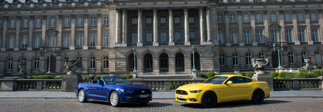 a blue 2018 Ford Mustang and a yellow 2018 Ford Mustang parked in Belgium