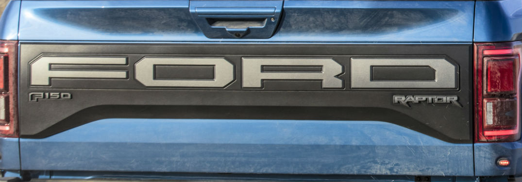 close up of the rear tailgate of a blue 2019 Ford F-150 Raptor
