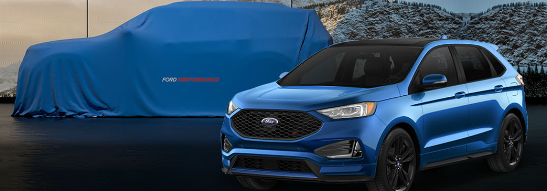 blue 2019 Ford Edge ST parked in front of a covered 2019 Ford Explorer ST