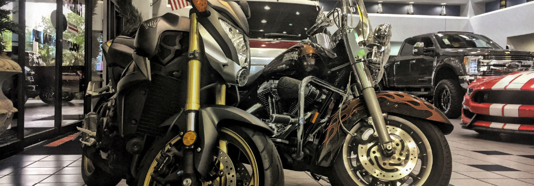 a pair of motorcycles in the Brandon Ford showroom