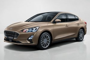 side view of a tan Asian 2019 Ford Focus Sedan